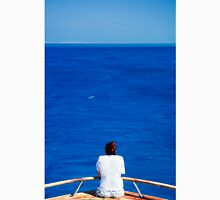 Woman looks out at an endless expanse of calm ocean Unisex T-Shirt