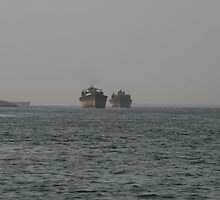 Old Ships coming into Dubai by Neil Grainger