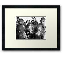 Kids play Framed Print