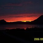A Sunset in Dutch Harbor by Kevin  Warrick