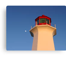 Moon rising over head of Peggys Cove Lighthouse Canvas Print