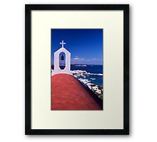 Greece. Cyclades Islands. Mykonos. Greek Orthodox Church and the harbour in Mykonos Town. Framed Print