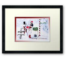 Rogue Snowman Framed Print
