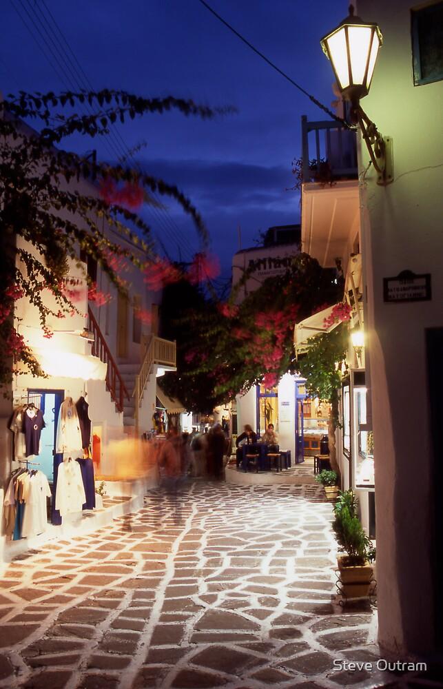 Greece. Cyclades Islands. Mykonos. An alleyway in Mykonos Town at night. by Steve Outram