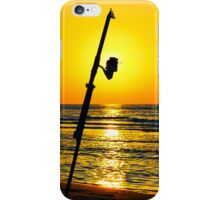 A fishing rod on the shore at sunset  iPhone Case/Skin