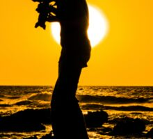 Silhouette of a photographer taking pictures on a beach at sunset Sticker