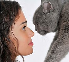 young female owner and a British Shorthair (AKA British blue) cat by PhotoStock-Isra