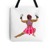 Female boxer flexes her muscles  Tote Bag