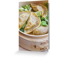 Streamed Gyoza (Jiaozi) in bamboo steaming basket  Greeting Card