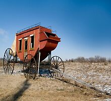 Old wagon on the Oregon trail near fort Kearney by PhotoStock-Isra