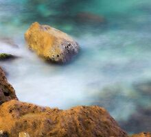 misty water spray and rocks by PhotoStock-Isra