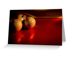 Christmas golden baubles on red background Greeting Card