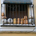 Squashes on a window balcony in Valencia , Spain by eeek