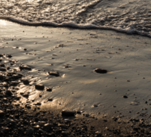 Golden Foam and Pebbles - Early Light at the Breakwater Sticker