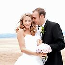 Bride and groom on beach 2 by nayamina