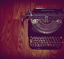 Typewriter on hardwood floor by ArtsByAlex