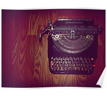 Typewriter on hardwood floor Poster