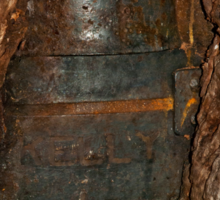 Ned Kelly Armour buried in old tree trunk Sticker