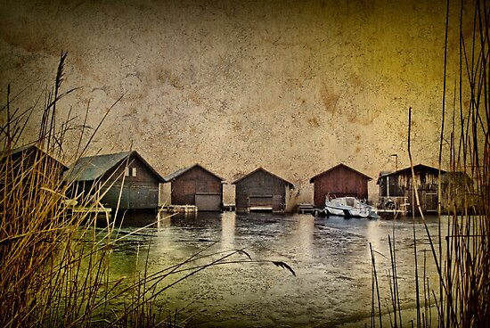Huts at the lake by Kurt  Tutschek