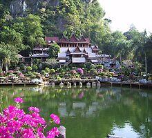 Buddhist monastery with water garden beneath cliffs by LeeLeon