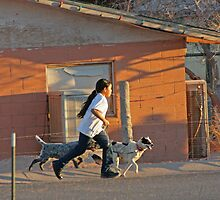 A girl and her dogs by coopphoto