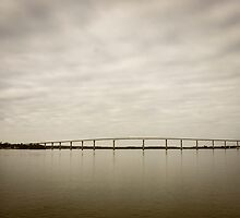 Bridge over a quiet river by Brent Olson