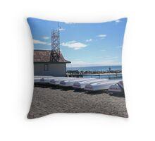 Boats on a beach Throw Pillow