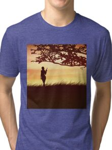 Silhouette of a girl with a butterfly and tree Tri-blend T-Shirt
