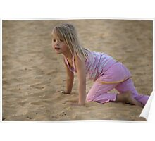 Young girl playing in the sand Poster