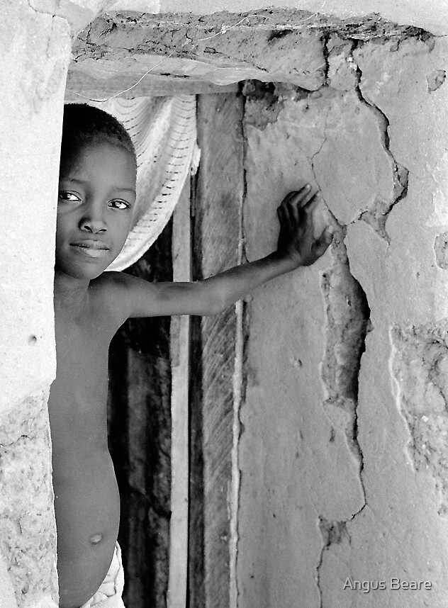 boy in Tonga village by Angus Beare