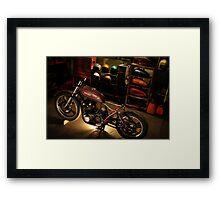 bike in the garage under construction Framed Print