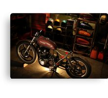 bike in the garage under construction Canvas Print