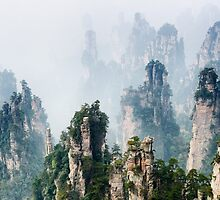 Mountain spires rising from fog at Zhangjiajie National Forest Park art photo print by ArtNudePhotos
