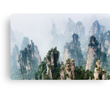 Mountain spires rising from fog at Zhangjiajie National Forest Park art photo print Canvas Print