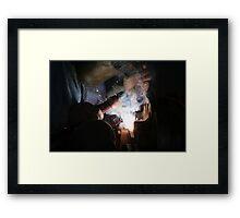 The Welder Framed Print