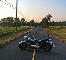 Motorcycle and open road by windrider