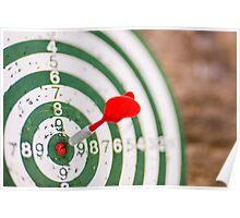 Red dart hits bull's eye Poster