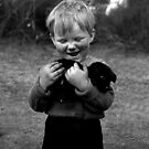 Gypsy boy with puppy by david malcolmson