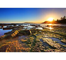 Golden Sunrays stretch across the reefs at sunset Photographic Print