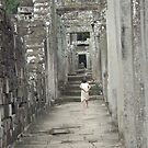 Local child at the Bayon by observer