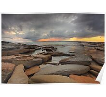 Sunrise, rocks and storm clouds Poster