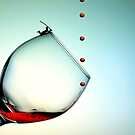 Fishing On A Glass Cup With Red Wine Droplets by Paul Ge