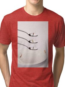 People Playing Golf On Spoons Tri-blend T-Shirt