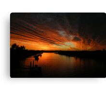 Fire in the evening sky  Canvas Print
