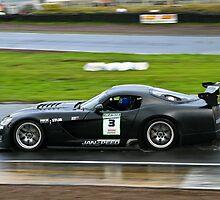 Black Dodge Viper racing flat out in the rain by John Stewart