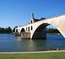 Bridge over Rhone river by windmill