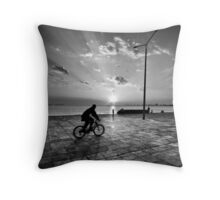 Sunset cyclist Throw Pillow