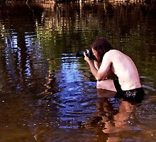 Photographer in River by Sadandal