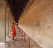 A monk browsing at Angkor Wat by Carmel Harty