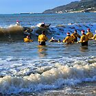 Surfing Santa's without boards at Charmouth Dorset UK by lynn carter